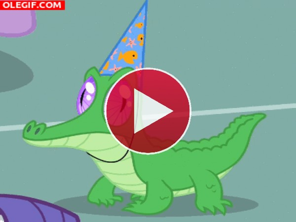 GIF: Pequeño cocodrilo bailando en una fiesta