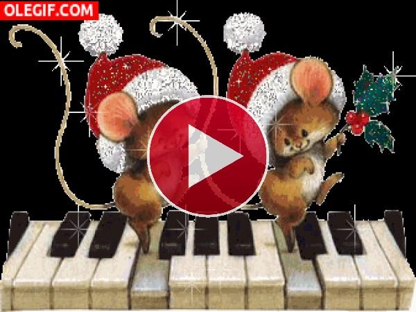 GIF: Ratones sobre un piano celebrando la Navidad