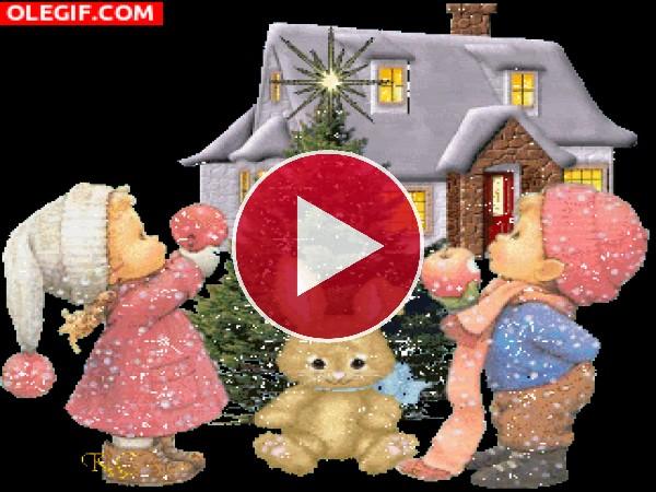 GIF: Niños junto al árbol de Navidad