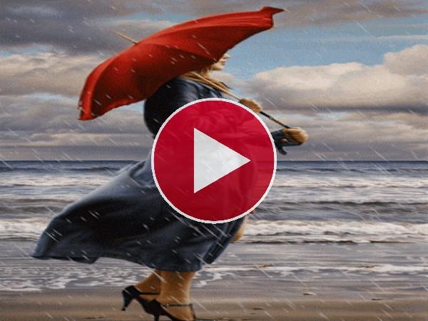 GIF: Mujer bajo la lluvia