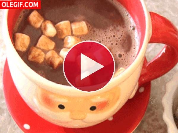 GIF: Malvaviscos sobre una taza de chocolate